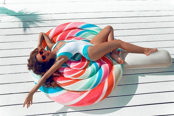 Slim girl having fun on colorful Inflata