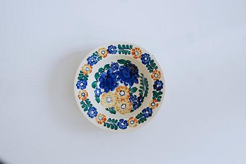 青とオレンジの花の小皿(中)