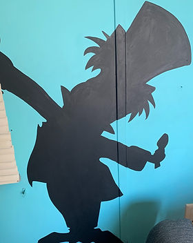 Mad Hatter painted on trailer wall
