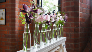 Mini milk bottle wedding flowers