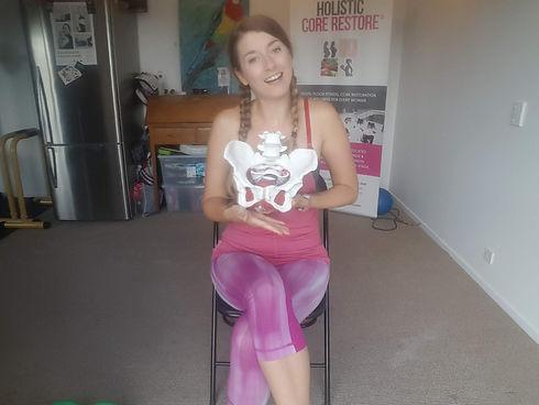 Amy Jayne Smith with a Pelvis Model