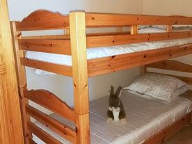 Le coin nuit avec 2 lits superposés de 90.