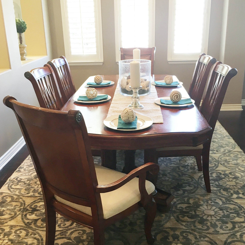 Removed 2 chairs and added light table top accessories to lighten up the dining room.