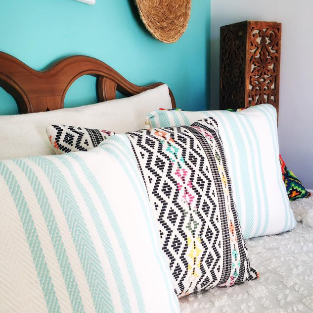 Layers of boho pillows.