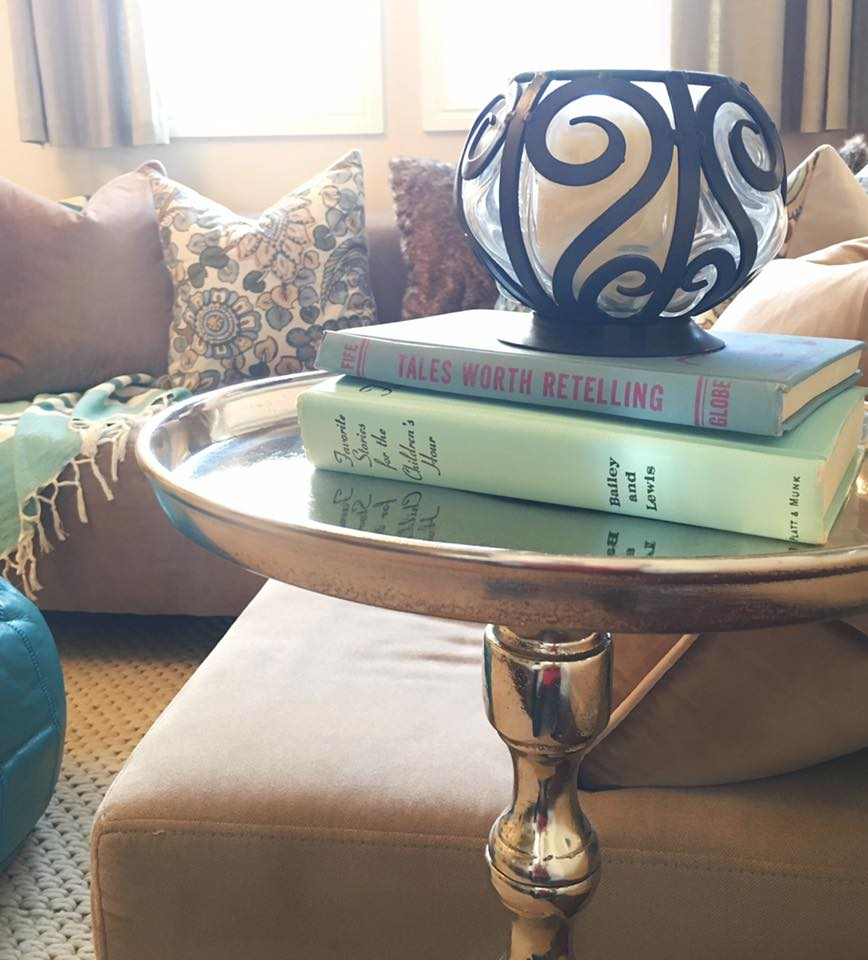 Reflective metal and vintage children's books in our color scheme.