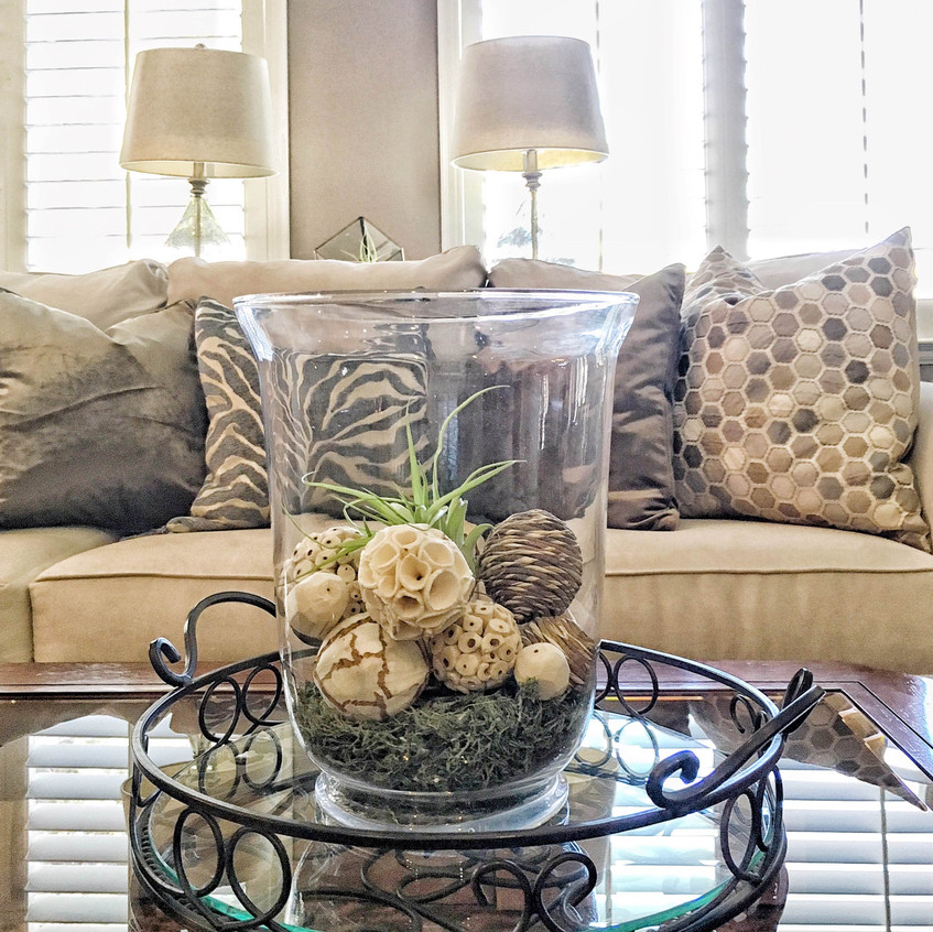 Layers of textured neutrals on the sofa.