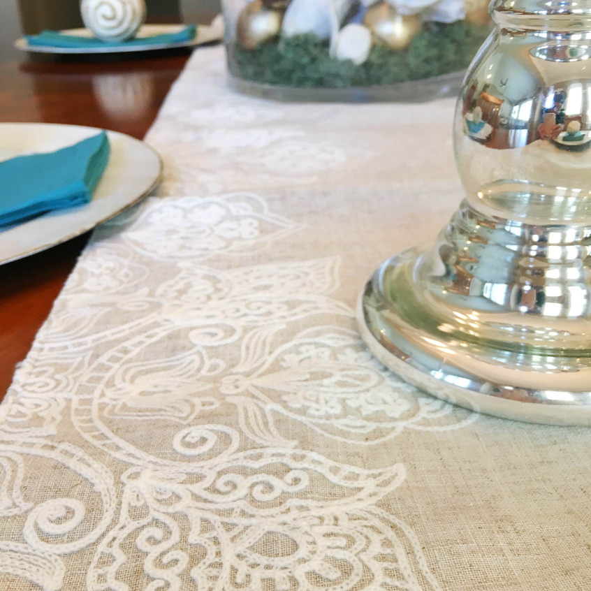 Textured neutral runner breaks up the large dining table.