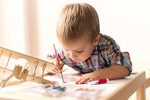 Child Painting Model Airplane