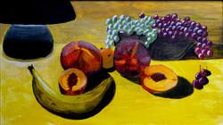 Still life of fruit under lamp light