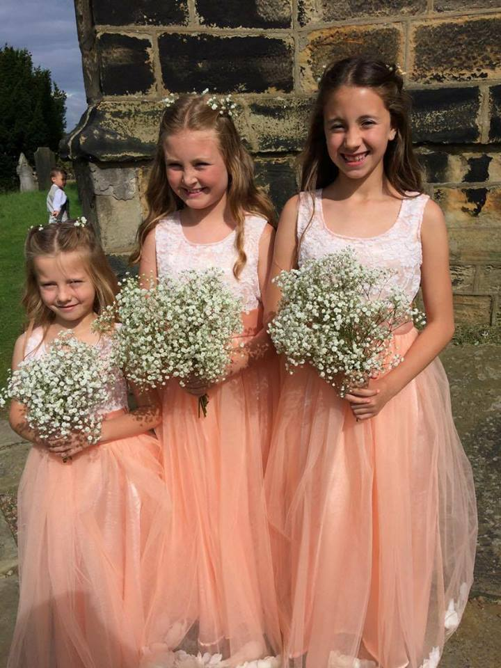 Petal dresses in peach and ivory