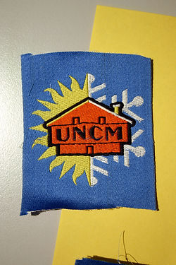 (112) Logo UNCM, collection Raymond GIre
