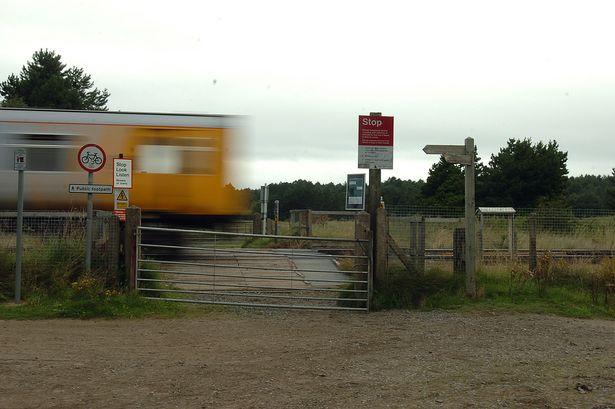 Fishermans Path Rail Crossing.jpg