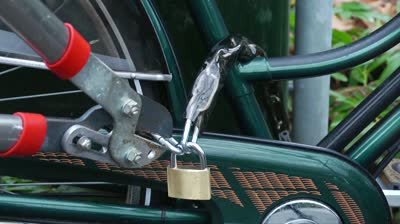 stock-footage-close-up-of-someone-stealing-a-bike-by-cutting-the-lock-of-a-bicyc