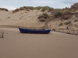 A boat washed up on the High Tide at Formby