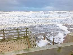 Very high tides today leaving just a narrow strip of beach available