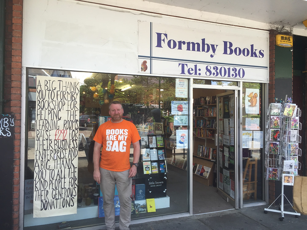 Tony Higginson on his final day at Formby Books.JPG