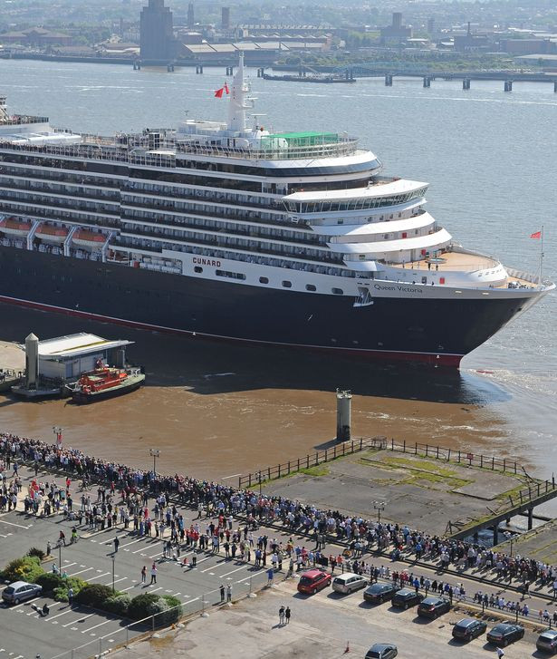 Crowds wave as Queen Victoria leaves Liverpool following her visit in 2014.jpg