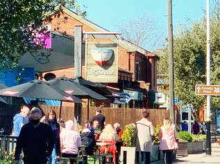 People enjoying the sun with a drink in pub gardens across Formby today as Stage Two lockdown begins