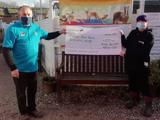 Friends of Squirrels Rotary Club present a cheque to Freshfields Animal Rescue