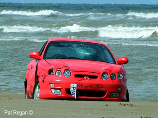 Two cars wrecked on Formby beach