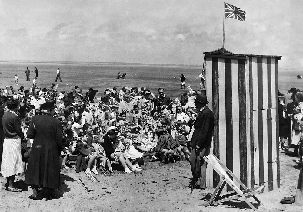 The inevitable Punch and Judy show on the crowded Southport Beach on 12th July 1
