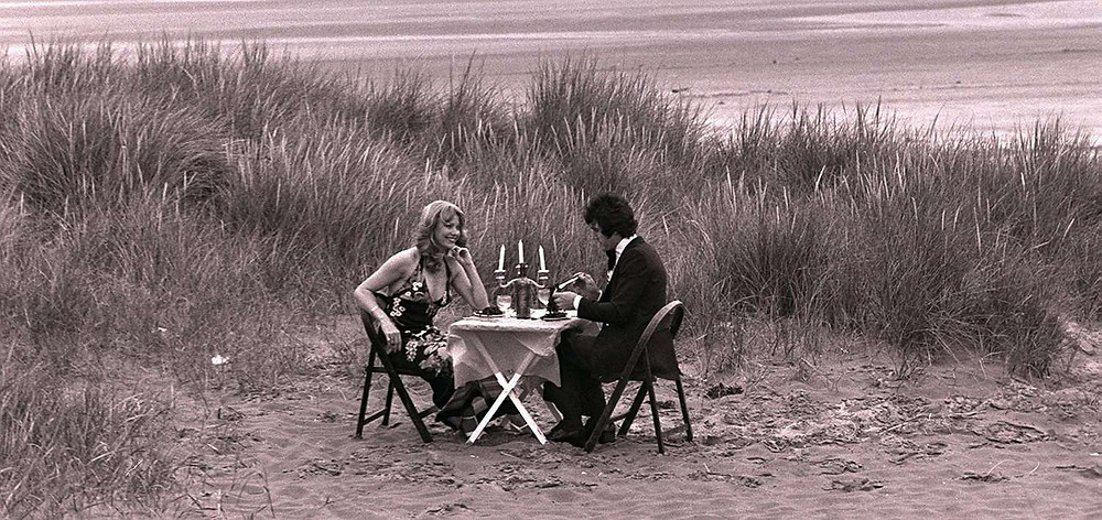People eating dinner on Formby Beach.jpg