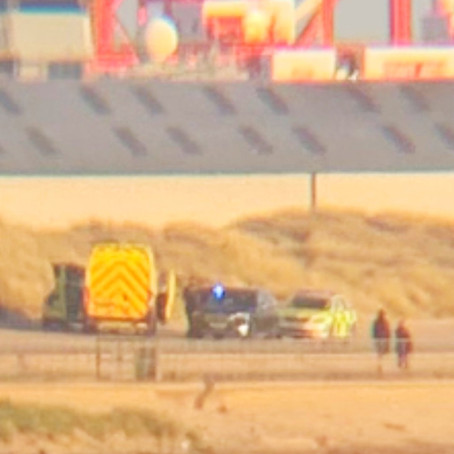 Emergency services called to a woman found in the water on Crosby beach in an unconscious state