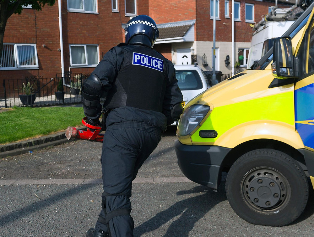 Police carried out raids in Southport, Bootle and Liverpool this morning.jpg