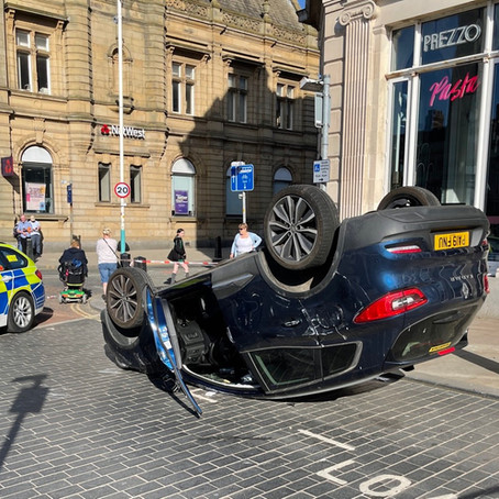 A car ended up on its roof in Sefton today after an RTC with a bus