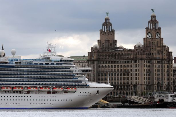 The Crown Princess cruise liner in front of the Liver Building during a visit to