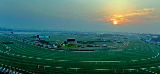 Sun rise over Aintree Race Course opening day 2015.jpg
