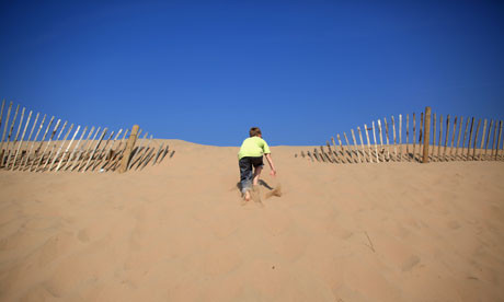 Young boy climbing sand dunes at Formby.jpg