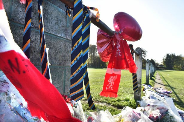 Floral tributes at Maghull cricket club for Liam Taylor.jpg