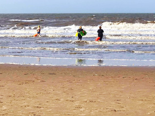 Swimmers enjoying Formby beach yesterday