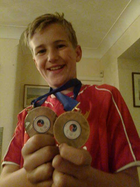 Owain Griffiths-Johnson won silver and bronze in spring karate tournament.jpg