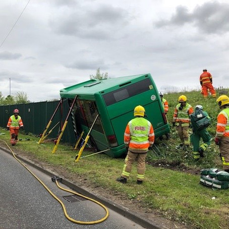 Fire crews rescued a bus which had tipped over in Fazakerley