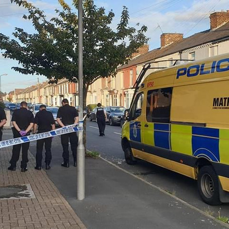 Two men arrested after police found a Glock handgun and bullets in Bootle