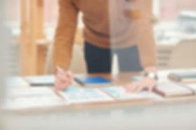 unrecognizable-businessman-planning-proj