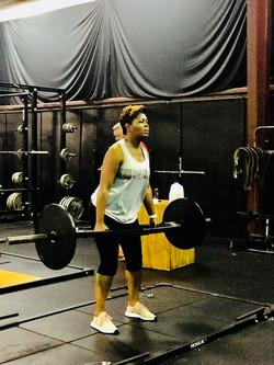 """alt=""""client Tanya doing squats"""""""