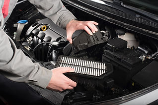 mechanic-changing-the-air-filter-on-a-ca
