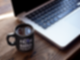 cup-of-coffee-mockup-near-a-macbook-a164