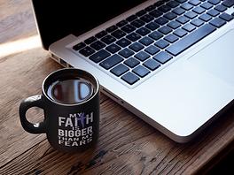 cup-of-coffee-mockup-near-a-macbook-a164