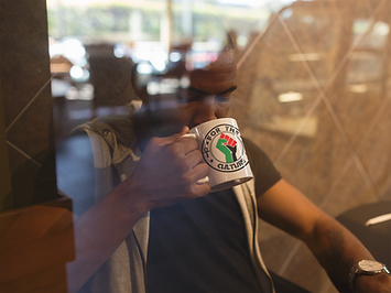 young-black-man-at-a-coffee-shop-drinkin