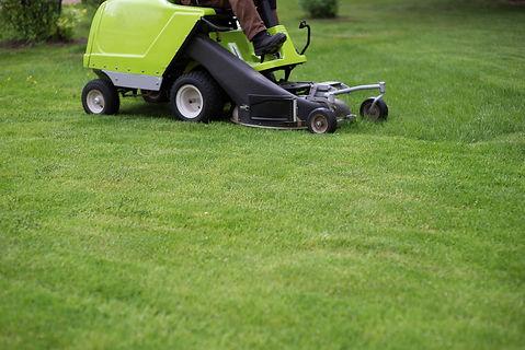 professional-lawn-mower-cuts-the-grass-R