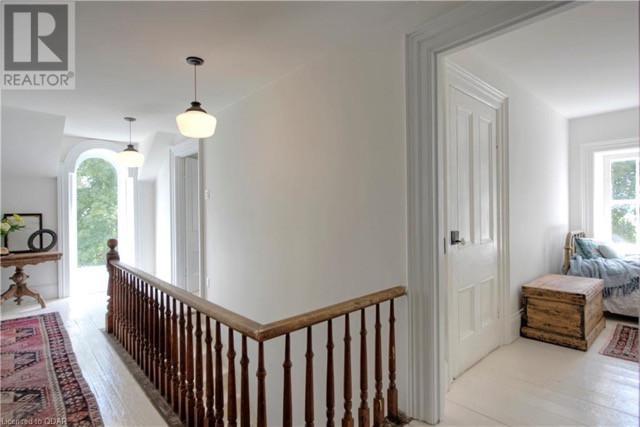 stair rails, wood floors, inside light