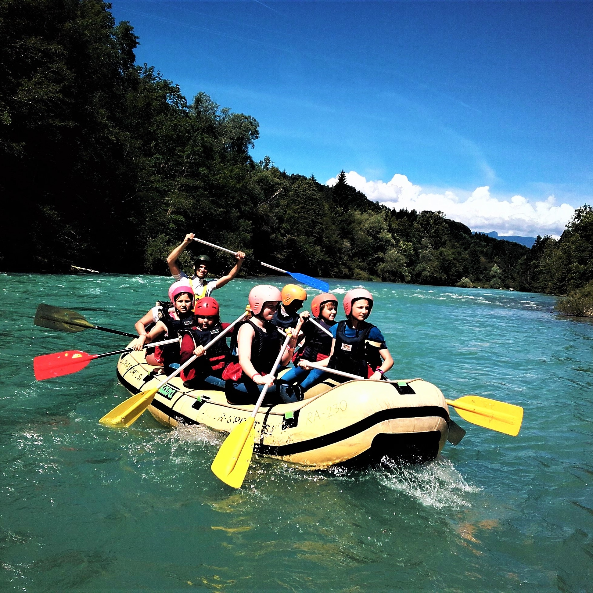 Paddling down the Sava river rafting Bled