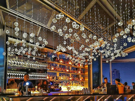 Of Dining & Bar above KL cityscape…