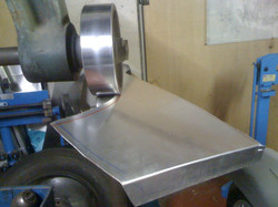 Using the wheel to turn a flange
