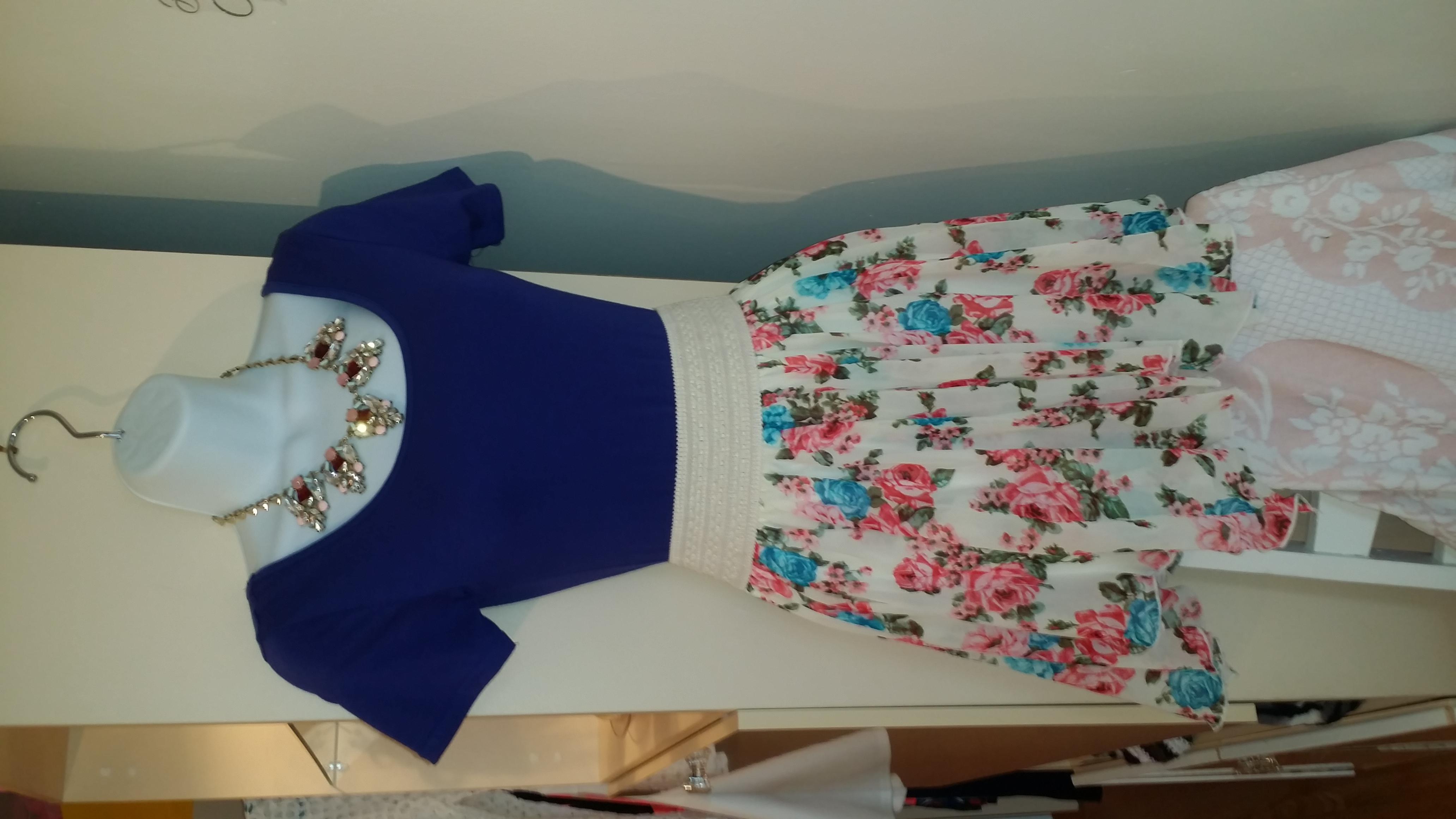 Mannequin blue blouse and floral skirt