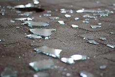 Shattered glass on a stone floor.jpg